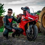 Production (Stock) Ducati Panigale V4, a person riding a motorcycle down a dirt road
