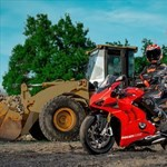 Production (Stock) Ducati Panigale V4, a tractor parked in the dirt