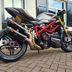 Production (Stock) Ducati Streetfighter, a motorcycle parked on the side of a building a Ducati Streetfighter Sportbike parked on the side of a building