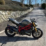 Production (Stock) Ducati Streetfighter, a motorcycle parked on the side of a road a Ducati Streetfighter Sportbike parked on the side of a road