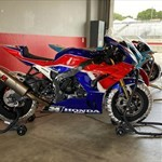 Production (Stock) Honda CBR1000RR, a motorcycle parked on the side of a building