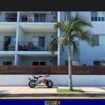 Production (Stock) Honda CBR900RR, a large white building with palm trees