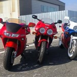 Production (Stock) Honda NR, a red motorcycle parked on the side of a building a red Honda NR Sportbike parked on the side of a building