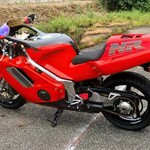 Production (Stock) Honda NR, a red and black motorcycle is parked on the side of a road a red and black Honda NR Sportbike is parked on the side of a road