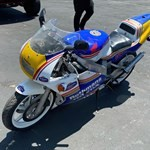 Production (Stock) Honda NSR250, a person riding a motorcycle in a parking lot
