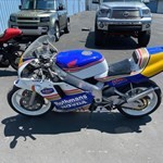 Production (Stock) Honda NSR250, a motorcycle parked in a parking lot