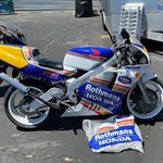 Production (Stock) Honda NSR250, a motorcycle parked on the side of a road