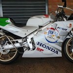 Production (Stock) Honda NSR250, a motorcycle parked on the side of a building