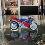 Models/R-C/Toys Honda RC30 VFR750R, a clock that is on display in a store