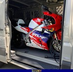 Production (Stock) Honda RC45 RVF750, a red and blue motorcycle a red and black Honda RVF750 RC45 Sportbike