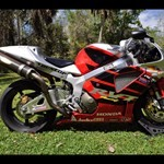 Production (Stock) Honda RC51, a motorcycle parked in a grassy area a Honda RC51 Sportbike parked in a grassy area