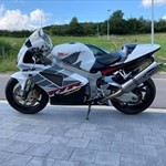 Production (Stock) Honda RC51, a motorcycle parked on the side of a road