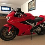 Production (Stock) Honda VFR Models, a motorcycle parked on the side of the room a Honda VFR Models Sportbike parked on the side of the room