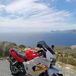 Production (Stock) Honda VFR Models, a motorcycle parked on the side of a mountain a Honda VFR Models Sportbike parked on the side of a mountain