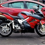 Production (Stock) Honda VFR Models, a motorcycle parked in front of a building a Honda VFR Models Sportbike parked in a parking lot