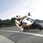 Production (Stock) KTM 1190 RC8, a man riding a motorcycle down the road a man riding a KTM 1190 RC8 Sportbike down the road