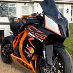 Production (Stock) KTM 1190 RC8, a motorcycle parked on the side of a building a KTM 1190 RC8 Sportbike parked on the side of a building