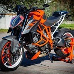 Production (Stock) KTM Duke Series, an orange motorcycle parked on the side of a road an orange KTM Duke Series Sportbike parked on the side of a road