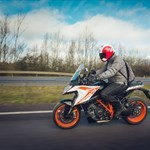 Production (Stock) KTM Duke Series, a man riding a motorcycle down a road a man riding a KTM Duke Series Sportbike down a road