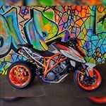 Production (Stock) KTM Duke Series, colorful graffiti on the side of the road
