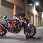 Production (Stock) KTM Duke Series, a motorcycle parked on the side of a building a KTM Duke Series Sportbike parked on the side of a building