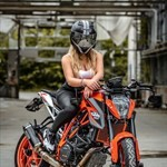 Production (Stock) KTM Duke Series, a person riding on the back of a motorcycle a person riding on the back of a KTM Duke Series Sportbike