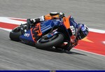 MotoGP Premier KTM Unknown (KTM), a person riding a motorcycle on a track a person riding a 2019 KTM  Sportbike on a track