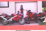 Production (Stock) Kawasaki GPZ Models, Kawasaki GPZ1100, red 1995  (bought brand new in 97 with only 2 miles on her). Totaled her July 23, 2000 on hwy.90 just outside of Jane,MO. (had 33,000 miles in 3 yrs.  Bought her back from insurance and rebuilt.  Lesson Learned: Don't ride past your limit just to catch up with the lead guy LOL!  But she is back & as beutiful and fast as ever ..... also in this pic is my 98 ZX-9R. Both fast bikes!! -Teresa