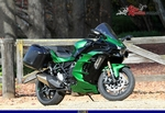 Production (Stock) Kawasaki H2/H2SE/H2SX/H2R Models, a green motorcycle parked on a dirt road a green Kawasaki H2/H2SE/H2SX/H2R Models Sportbike parked on a dirt road