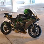 Production (Stock) Kawasaki H2/H2SE/H2SX/H2R Models, a motorcycle parked on the side of the road a Kawasaki H2/H2SE/H2SX/H2R Models Sportbike parked on the side of the road