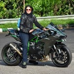 Production (Stock) Kawasaki H2/H2SE/H2SX/H2R Models, a person riding a motorcycle down a dirt road a person riding a Kawasaki H2/H2SE/H2SX/H2R Models Sportbike down a dirt road