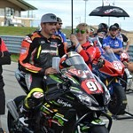 Misc. Racing Kawasaki Ninja ZX-10R, a group of people riding on the back of a motorcycle a group of people riding on the back of a 2019 Kawasaki Ninja ZX-10R Sportbike