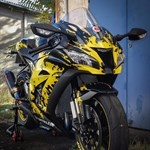 Production (Custom) Kawasaki Ninja ZX-10R, a black and yellow motorcycle parked on the side of a building a black and yellow Kawasaki Ninja ZX-10R Sportbike parked on the side of a building