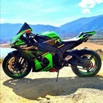 Production (Stock) Kawasaki Ninja ZX-10R, a motorcycle parked on the side of a dirt field a Kawasaki Ninja ZX-10R Sportbike parked on the side of a dirt field
