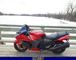 Production (Stock) Kawasaki Ninja ZX-14R, a red and black motorcycle parked on the side of the road a red and black Kawasaki Ninja ZX-14 Sportbike parked on the side of the road