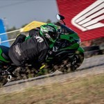 Production (Stock) Kawasaki Ninja ZX-14R, a person riding a motorcycle on a track a person riding a Kawasaki Ninja ZX-14R Sportbike on a track