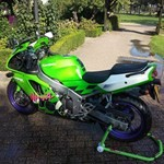 Production (Stock) Kawasaki Ninja ZX-6R, a green motorcycle parked on the side of a road a green Kawasaki Ninja ZX-6R Sportbike parked on the side of a road
