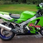 Production (Stock) Kawasaki Ninja ZX-6R, a green motorcycle parked on the side of the road a green Kawasaki Ninja ZX-6R Sportbike parked on the side of the road