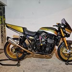 Production (Stock) Kawasaki ZXR Models, a black and yellow motorcycle parked on the side a black and yellow Kawasaki ZXR Models Sportbike parked on the side