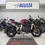 Production (Stock) MV Agusta Brutale series, a motorcycle parked on the side of a building a 2020 MV Agusta Brutale series Sportbike parked on the side of a building