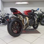 Production (Stock) MV Agusta Brutale series, a red and black motorcycle is parked on the side of a building a red and black 2020 MV Agusta Brutale series Sportbike is parked on the side of a building