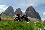 Production (Stock) MV Agusta Brutale series, a motorcycle parked on the side of Dolomites a MV Agusta Brutale series Sportbike parked on the side of Dolomites