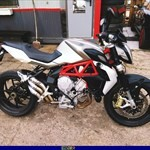 Production (Stock) MV Agusta Brutale series, a motorcycle is parked in the dirt a MV Agusta Brutale series Sportbike is parked in the dirt