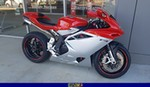 Production (Stock) MV Agusta F4 series, a red and black motorcycle is parked on the side of a building a red and black MV Agusta F4 series Sportbike is parked on the side of a building