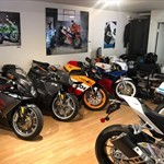 Production (Stock) MV Agusta F4 series, a row of parked motorcycles sitting on the side of the room a row of parked MV Agusta F4 series Sportbikes sitting on the side of the room