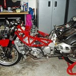 Production (Stock) MV Agusta F4 series, a red motorcycle parked in a room a red MV Agusta F4 series Sportbike parked in a room