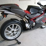 Production (Stock) MV Agusta F4 series, a motorcycle parked on the side of a road a MV Agusta F4 series Sportbike parked on the side of a road