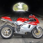 Production (Stock) MV Agusta F4 series, a motorcycle parked on the side of the road a MV Agusta F4 series Sportbike parked on the side of the road