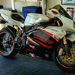 Production (Stock) MV Agusta F4 series, a motorcycle is parked on the side a MV Agusta F4 series Sportbike is parked on the side