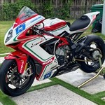 Production (Stock) MV F3, a motorcycle parked on the side of the road a MV F3 Sportbike parked on the side of the road
